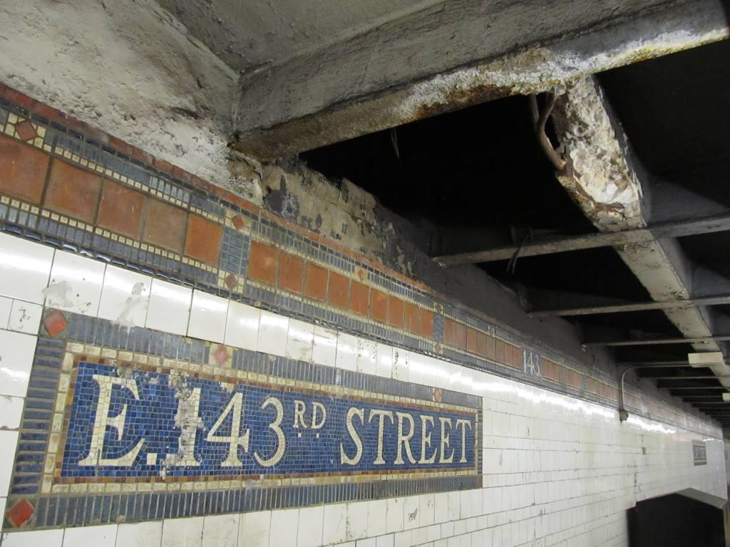 (123k, 1024x768)<br><b>Country:</b> United States<br><b>City:</b> New York<br><b>System:</b> New York City Transit<br><b>Line:</b> IRT Pelham Line<br><b>Location:</b> East 143rd Street <br><b>Photo by:</b> Robbie Rosenfeld<br><b>Date:</b> 5/24/2011<br><b>Notes:</b> Mosaic tile that could use some restoration.<br><b>Viewed (this week/total):</b> 1 / 1046
