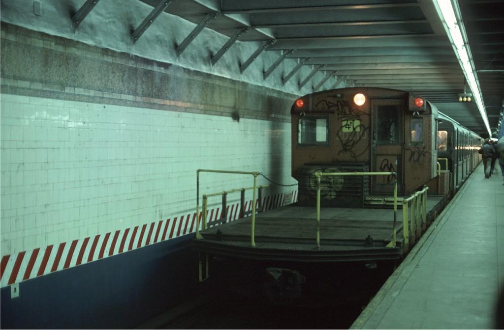 (146k, 1024x672)<br><b>Country:</b> United States<br><b>City:</b> New York<br><b>System:</b> New York City Transit<br><b>Line:</b> BMT 4th Avenue<br><b>Location:</b> 95th Street/Fort Hamilton <br><b>Route:</b> Fan Trip<br><b>Car:</b> R-3 Motor Flat Car (Drill Motor) (Magor Car, 1932)  41 <br><b>Photo by:</b> Ed McKernan<br><b>Collection of:</b> Joe Testagrose<br><b>Date:</b> 3/20/1977<br><b>Viewed (this week/total):</b> 0 / 1691