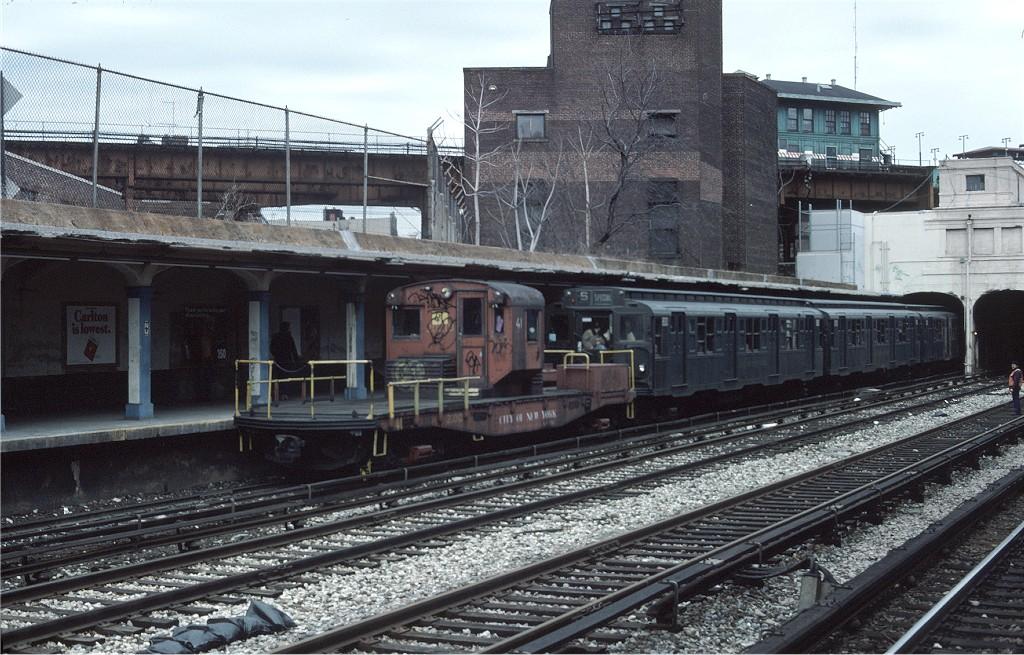 (230k, 1024x655)<br><b>Country:</b> United States<br><b>City:</b> New York<br><b>System:</b> New York City Transit<br><b>Line:</b> BMT Sea Beach Line<br><b>Location:</b> New Utrecht Avenue <br><b>Route:</b> Fan Trip<br><b>Car:</b> R-3 Motor Flat Car (Drill Motor) (Magor Car, 1932)  41 <br><b>Photo by:</b> Ed McKernan<br><b>Collection of:</b> Joe Testagrose<br><b>Date:</b> 3/20/1977<br><b>Viewed (this week/total):</b> 0 / 1272