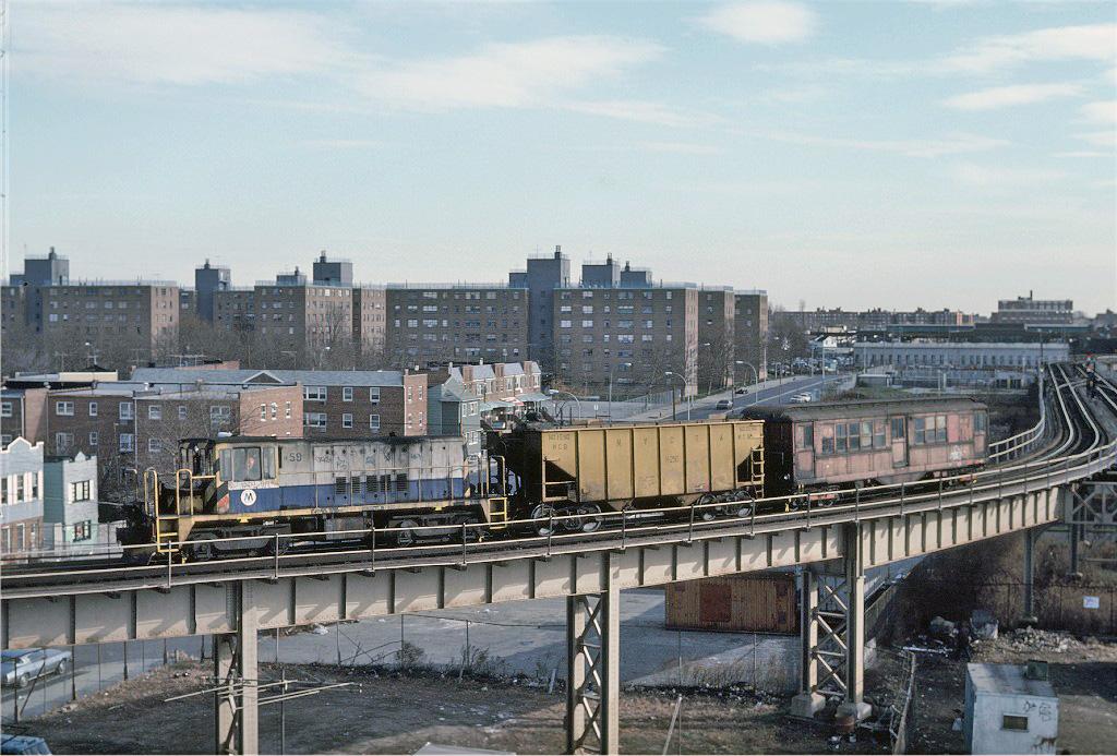 (287k, 1024x693)<br><b>Country:</b> United States<br><b>City:</b> New York<br><b>System:</b> New York City Transit<br><b>Line:</b> BMT West End Line<br><b>Location:</b> Bay 50th Street <br><b>Route:</b> Work Service<br><b>Car:</b> R-41 Locomotive  59 <br><b>Photo by:</b> Steve Zabel<br><b>Collection of:</b> Joe Testagrose<br><b>Date:</b> 12/10/1981<br><b>Viewed (this week/total):</b> 2 / 1310