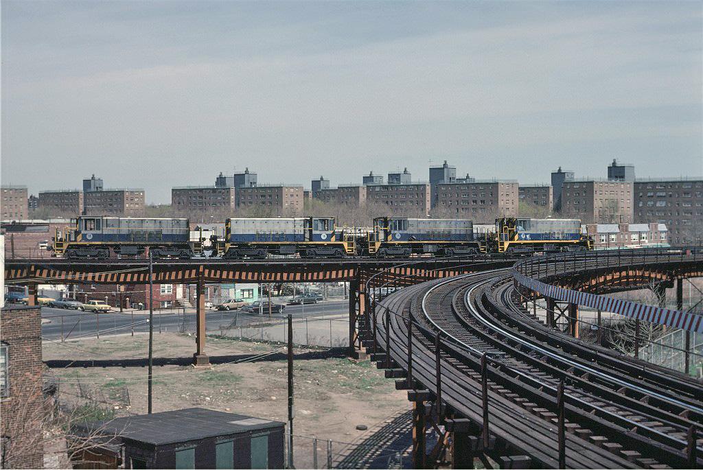 (314k, 1024x685)<br><b>Country:</b> United States<br><b>City:</b> New York<br><b>System:</b> New York City Transit<br><b>Line:</b> BMT West End Line<br><b>Location:</b> Bay 50th Street <br><b>Route:</b> Work Service<br><b>Car:</b> R-47 Locomotive  64 <br><b>Photo by:</b> Joe Testagrose<br><b>Date:</b> 4/16/1977<br><b>Notes:</b> Left to right, 64/68/70/69<br><b>Viewed (this week/total):</b> 3 / 1249