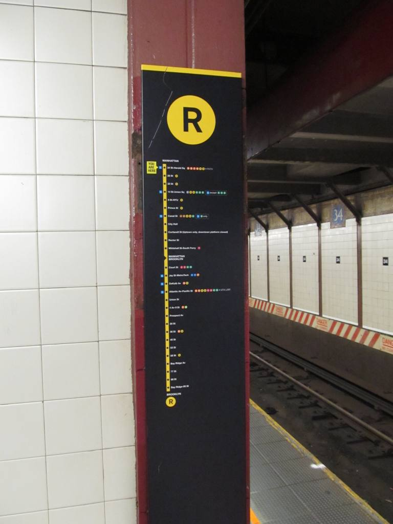 (67k, 768x1024)<br><b>Country:</b> United States<br><b>City:</b> New York<br><b>System:</b> New York City Transit<br><b>Line:</b> BMT Broadway Line<br><b>Location:</b> 34th Street/Herald Square <br><b>Photo by:</b> Robbie Rosenfeld<br><b>Date:</b> 7/4/2011<br><b>Notes:</b> New route map on column.<br><b>Viewed (this week/total):</b> 0 / 1273