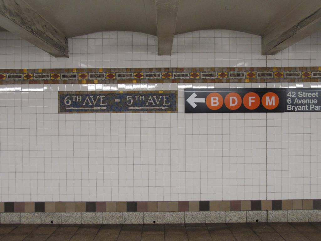 (85k, 1024x768)<br><b>Country:</b> United States<br><b>City:</b> New York<br><b>System:</b> New York City Transit<br><b>Line:</b> IRT Flushing Line<br><b>Location:</b> 5th Avenue <br><b>Photo by:</b> Robbie Rosenfeld<br><b>Date:</b> 6/14/2011<br><b>Notes:</b> Mosaic signs and tile band in mezzanine.<br><b>Viewed (this week/total):</b> 1 / 1245
