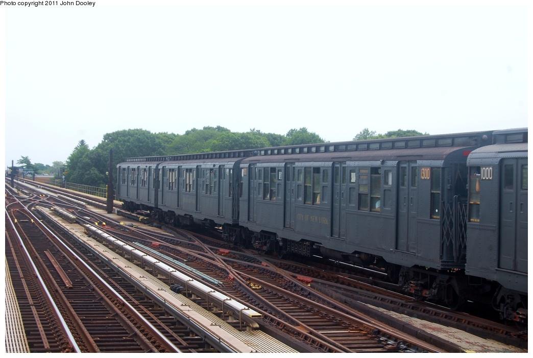 (261k, 1044x701)<br><b>Country:</b> United States<br><b>City:</b> New York<br><b>System:</b> New York City Transit<br><b>Line:</b> IND Fulton Street Line<br><b>Location:</b> 80th Street/Hudson Street <br><b>Route:</b> NT<br><b>Car:</b> R-6-1 (Pressed Steel, 1936)  1300 <br><b>Photo by:</b> John Dooley<br><b>Date:</b> 7/23/2011<br><b>Viewed (this week/total):</b> 0 / 553