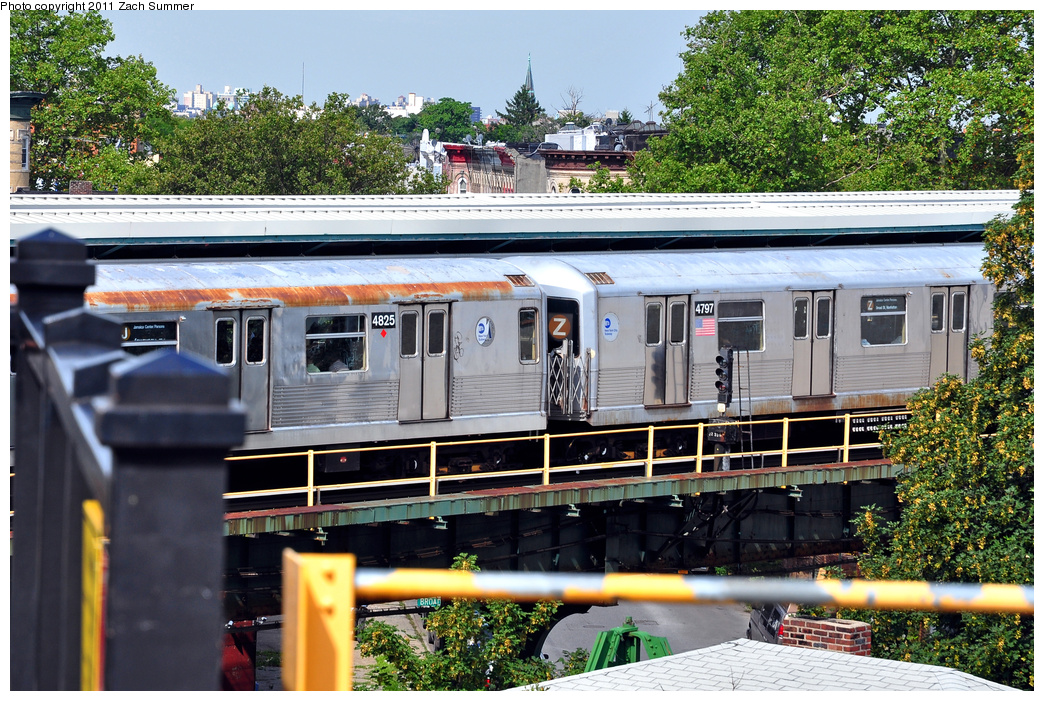 (498k, 1044x701)<br><b>Country:</b> United States<br><b>City:</b> New York<br><b>System:</b> New York City Transit<br><b>Line:</b> BMT Nassau Street/Jamaica Line<br><b>Location:</b> Broadway/East New York (Broadway Junction) <br><b>Route:</b> J<br><b>Car:</b> R-42 (St. Louis, 1969-1970)  4825/4797 <br><b>Photo by:</b> Zach Summer<br><b>Date:</b> 7/28/2011<br><b>Viewed (this week/total):</b> 2 / 911