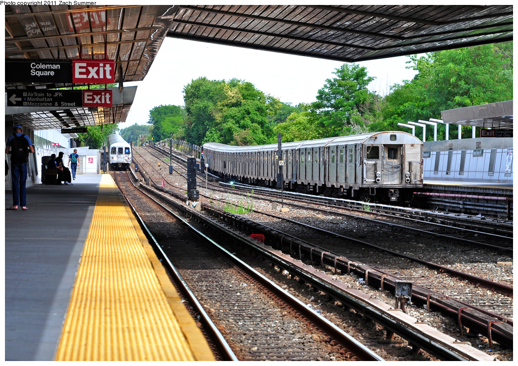 (541k, 1044x738)<br><b>Country:</b> United States<br><b>City:</b> New York<br><b>System:</b> New York City Transit<br><b>Line:</b> IND Rockaway<br><b>Location:</b> Howard Beach <br><b>Route:</b> A<br><b>Car:</b> R-32 (Budd, 1964)  3449 <br><b>Photo by:</b> Zach Summer<br><b>Date:</b> 7/28/2011<br><b>Notes:</b> R46 5942 on the A approaching Howard Beach<br><b>Viewed (this week/total):</b> 0 / 1319