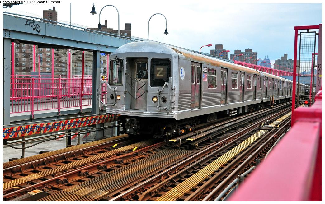 (468k, 1044x656)<br><b>Country:</b> United States<br><b>City:</b> New York<br><b>System:</b> New York City Transit<br><b>Line:</b> BMT Nassau Street/Jamaica Line<br><b>Location:</b> Williamsburg Bridge<br><b>Route:</b> Z<br><b>Car:</b> R-42 (St. Louis, 1969-1970)  4826 <br><b>Photo by:</b> Zach Summer<br><b>Date:</b> 7/28/2011<br><b>Viewed (this week/total):</b> 0 / 1126