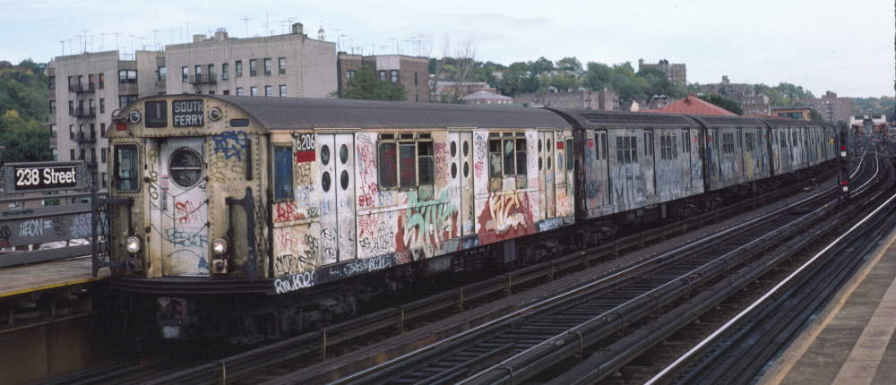 (63k, 1000x430)<br><b>Country:</b> United States<br><b>City:</b> New York<br><b>System:</b> New York City Transit<br><b>Line:</b> IRT West Side Line<br><b>Location:</b> 238th Street <br><b>Route:</b> 1<br><b>Car:</b> R-15 (American Car & Foundry, 1950) 6206 <br><b>Photo by:</b> Robert Callahan<br><b>Date:</b> 10/14/1984<br><b>Viewed (this week/total):</b> 0 / 1336