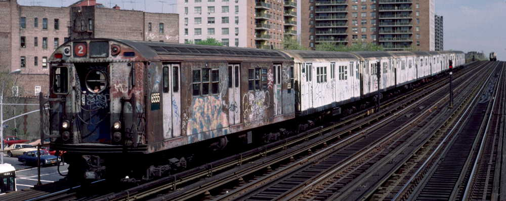 (62k, 1000x397)<br><b>Country:</b> United States<br><b>City:</b> New York<br><b>System:</b> New York City Transit<br><b>Line:</b> IRT White Plains Road Line<br><b>Location:</b> Pelham Parkway <br><b>Route:</b> 2<br><b>Car:</b> R-17 (St. Louis, 1955-56) 6555 <br><b>Photo by:</b> Robert Callahan<br><b>Date:</b> 4/1985<br><b>Viewed (this week/total):</b> 1 / 1270