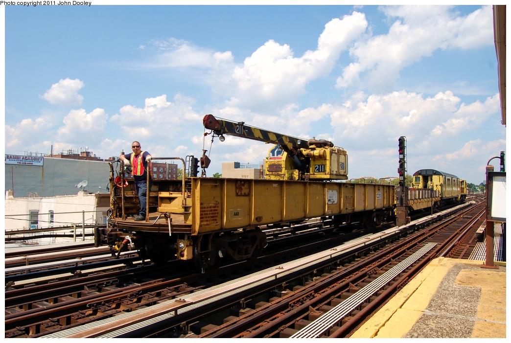 (340k, 1044x701)<br><b>Country:</b> United States<br><b>City:</b> New York<br><b>System:</b> New York City Transit<br><b>Line:</b> BMT Culver Line<br><b>Location:</b> Avenue X <br><b>Route:</b> Work Service<br><b>Car:</b> R-61 Telescoping Boom Crane (Fuji, 1982)  211 <br><b>Photo by:</b> John Dooley<br><b>Date:</b> 8/10/2011<br><b>Viewed (this week/total):</b> 3 / 712