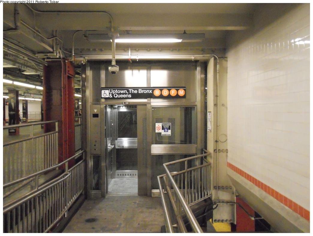 (289k, 1044x788)<br><b>Country:</b> United States<br><b>City:</b> New York<br><b>System:</b> New York City Transit<br><b>Line:</b> IND 6th Avenue Line<br><b>Location:</b> 47-50th Street/Rockefeller Center <br><b>Photo by:</b> Roberto C. Tobar<br><b>Date:</b> 7/30/2011<br><b>Notes:</b> Elevator-mezzanine level<br><b>Viewed (this week/total):</b> 3 / 1343