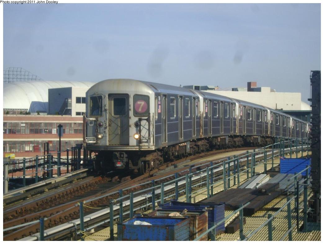 (269k, 1044x788)<br><b>Country:</b> United States<br><b>City:</b> New York<br><b>System:</b> New York City Transit<br><b>Line:</b> IRT Flushing Line<br><b>Location:</b> 33rd Street/Rawson Street <br><b>Route:</b> 7<br><b>Car:</b> R-62A (Bombardier, 1984-1987)  1766 <br><b>Photo by:</b> John Dooley<br><b>Date:</b> 4/14/2011<br><b>Viewed (this week/total):</b> 0 / 923