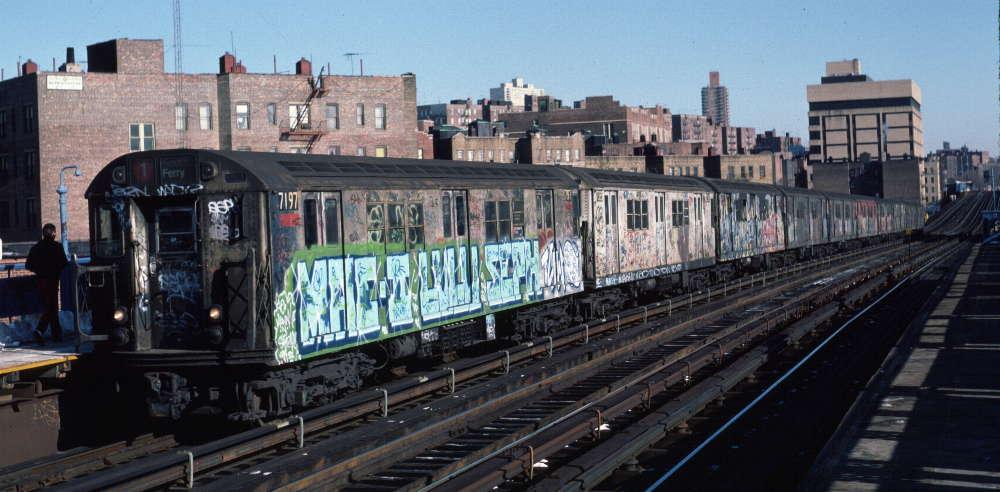 (72k, 1000x492)<br><b>Country:</b> United States<br><b>City:</b> New York<br><b>System:</b> New York City Transit<br><b>Line:</b> IRT West Side Line<br><b>Location:</b> 207th Street <br><b>Route:</b> 1<br><b>Car:</b> R-21 (St. Louis, 1956-57) 7197 <br><b>Photo by:</b> Robert Callahan<br><b>Date:</b> 2/10/1985<br><b>Viewed (this week/total):</b> 1 / 1035