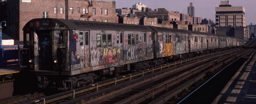 (67k, 1000x406)<br><b>Country:</b> United States<br><b>City:</b> New York<br><b>System:</b> New York City Transit<br><b>Line:</b> IRT West Side Line<br><b>Location:</b> 207th Street <br><b>Route:</b> 1<br><b>Car:</b> R-21 (St. Louis, 1956-57) 7199 <br><b>Photo by:</b> Robert Callahan<br><b>Date:</b> 2/16/1985<br><b>Viewed (this week/total):</b> 0 / 1055