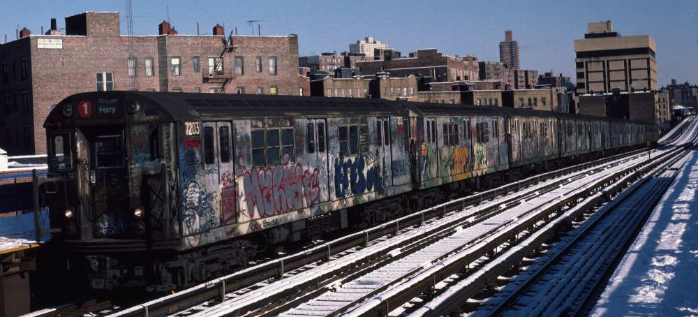 (71k, 1000x454)<br><b>Country:</b> United States<br><b>City:</b> New York<br><b>System:</b> New York City Transit<br><b>Line:</b> IRT West Side Line<br><b>Location:</b> 207th Street <br><b>Route:</b> 1<br><b>Car:</b> R-21 (St. Louis, 1956-57) 7203 <br><b>Photo by:</b> Robert Callahan<br><b>Date:</b> 2/3/1985<br><b>Viewed (this week/total):</b> 2 / 948
