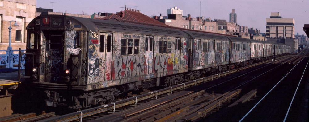 (65k, 1000x397)<br><b>Country:</b> United States<br><b>City:</b> New York<br><b>System:</b> New York City Transit<br><b>Line:</b> IRT West Side Line<br><b>Location:</b> 207th Street <br><b>Route:</b> 1<br><b>Car:</b> R-21 (St. Louis, 1956-57) 7242 <br><b>Photo by:</b> Robert Callahan<br><b>Date:</b> 2/16/1985<br><b>Viewed (this week/total):</b> 1 / 902