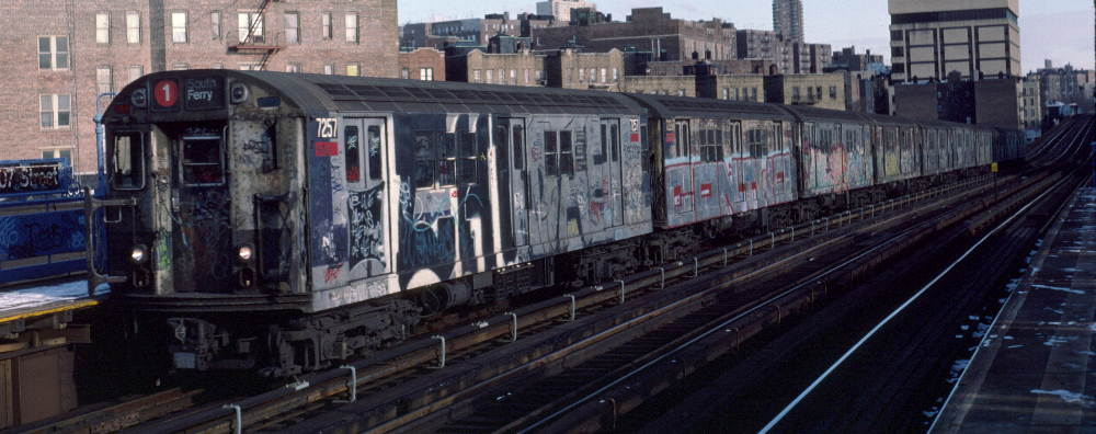 (69k, 1000x396)<br><b>Country:</b> United States<br><b>City:</b> New York<br><b>System:</b> New York City Transit<br><b>Line:</b> IRT West Side Line<br><b>Location:</b> 207th Street <br><b>Route:</b> 1<br><b>Car:</b> R-21 (St. Louis, 1956-57) 7257 <br><b>Photo by:</b> Robert Callahan<br><b>Date:</b> 2/12/1985<br><b>Viewed (this week/total):</b> 0 / 1271