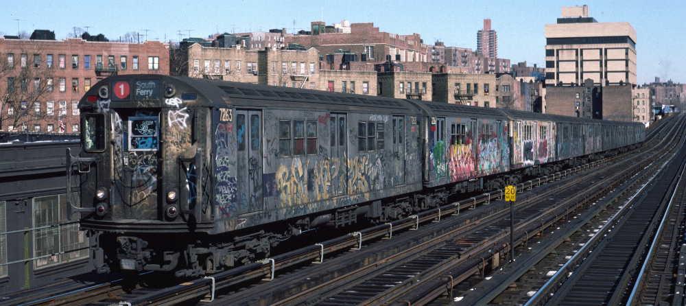 (67k, 1000x446)<br><b>Country:</b> United States<br><b>City:</b> New York<br><b>System:</b> New York City Transit<br><b>Line:</b> IRT West Side Line<br><b>Location:</b> 207th Street <br><b>Route:</b> 1<br><b>Car:</b> R-21 (St. Louis, 1956-57) 7263 <br><b>Photo by:</b> Robert Callahan<br><b>Date:</b> 2/10/1985<br><b>Viewed (this week/total):</b> 0 / 922