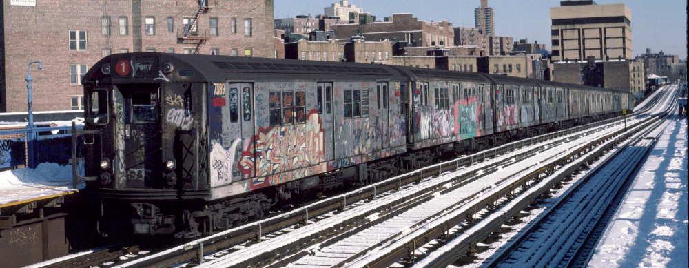(69k, 1000x389)<br><b>Country:</b> United States<br><b>City:</b> New York<br><b>System:</b> New York City Transit<br><b>Line:</b> IRT West Side Line<br><b>Location:</b> 207th Street<br><b>Route:</b> 1<br><b>Car:</b> R-22 (St. Louis, 1957-58) 7389 <br><b>Photo by:</b> Robert Callahan<br><b>Date:</b> 2/3/1985<br><b>Viewed (this week/total):</b> 1 / 1244