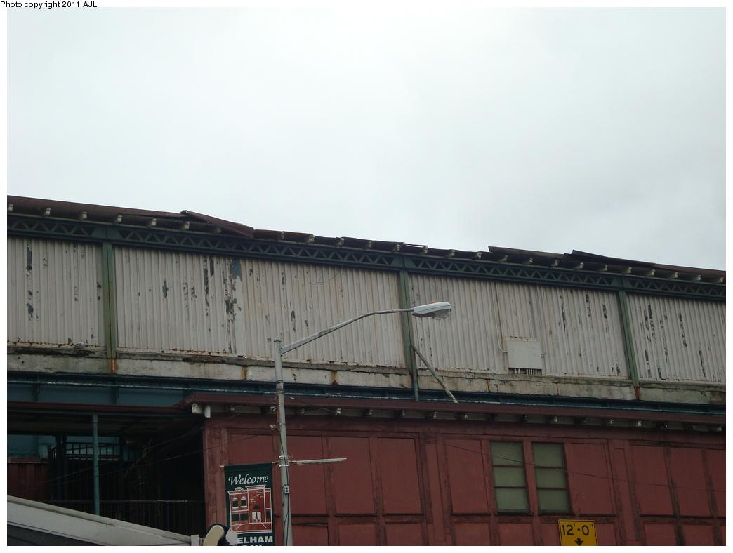 (220k, 1044x788)<br><b>Country:</b> United States<br><b>City:</b> New York<br><b>System:</b> New York City Transit<br><b>Line:</b> IRT Pelham Line<br><b>Location:</b> Buhre Avenue <br><b>Photo by:</b> Anthony J. Liccese<br><b>Date:</b> 8/28/2011<br><b>Notes:</b> Roof damage from Hurricane Irene<br><b>Viewed (this week/total):</b> 0 / 978