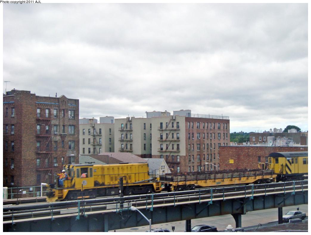 (360k, 1044x788)<br><b>Country:</b> United States<br><b>City:</b> New York<br><b>System:</b> New York City Transit<br><b>Line:</b> IRT Pelham Line<br><b>Location:</b> Buhre Avenue <br><b>Route:</b> Work Service<br><b>Car:</b> R-41 Locomotive  59 <br><b>Photo by:</b> Anthony J. Liccese<br><b>Date:</b> 8/28/2011<br><b>Notes:</b> Testing track between Buhre Avenue and Pelham Bay Park after Hurricane Irene<br><b>Viewed (this week/total):</b> 4 / 1202