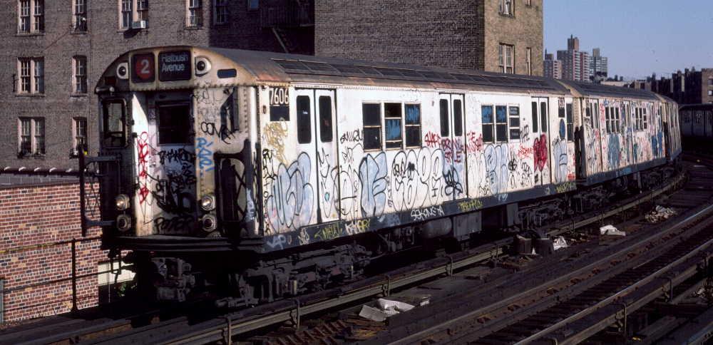 (73k, 1000x484)<br><b>Country:</b> United States<br><b>City:</b> New York<br><b>System:</b> New York City Transit<br><b>Line:</b> IRT White Plains Road Line<br><b>Location:</b> Bronx Park East <br><b>Route:</b> 2<br><b>Car:</b> R-22 (St. Louis, 1957-58) 7606 <br><b>Photo by:</b> Robert Callahan<br><b>Date:</b> 3/9/1985<br><b>Viewed (this week/total):</b> 0 / 865