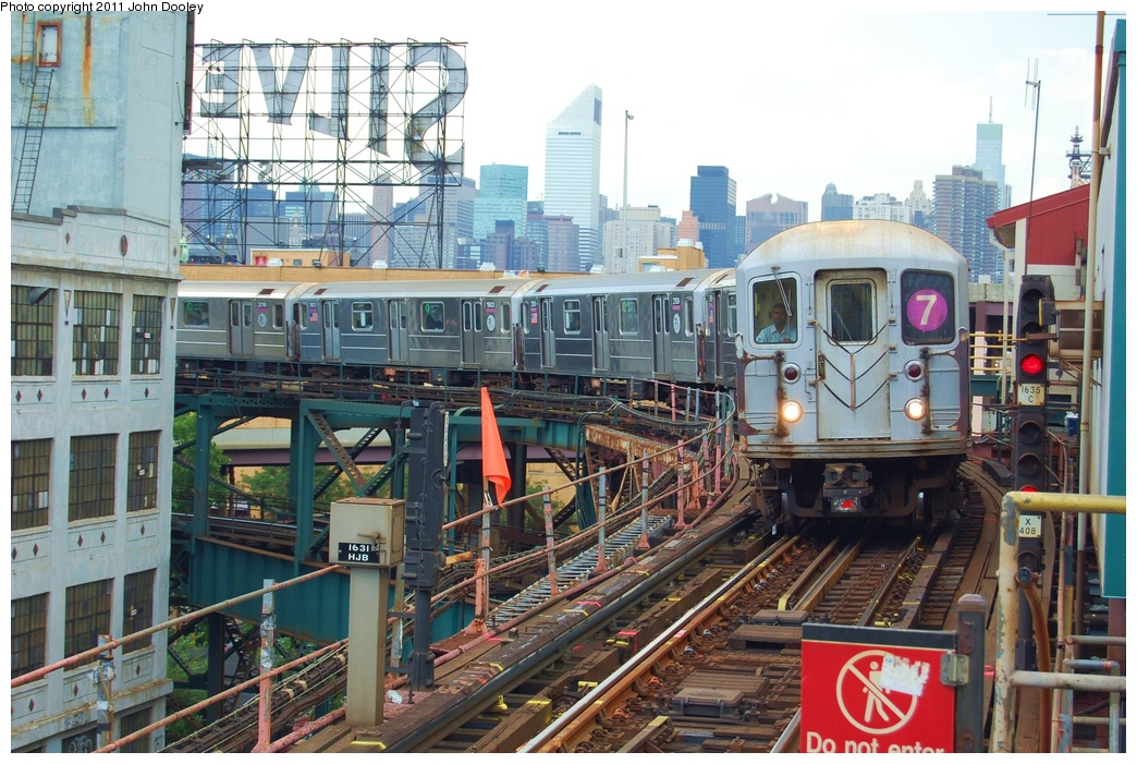 (369k, 1044x701)<br><b>Country:</b> United States<br><b>City:</b> New York<br><b>System:</b> New York City Transit<br><b>Line:</b> IRT Flushing Line<br><b>Location:</b> Queensborough Plaza <br><b>Route:</b> 7<br><b>Car:</b> R-62A (Bombardier, 1984-1987)  2111 <br><b>Photo by:</b> John Dooley<br><b>Date:</b> 6/27/2011<br><b>Viewed (this week/total):</b> 1 / 1115