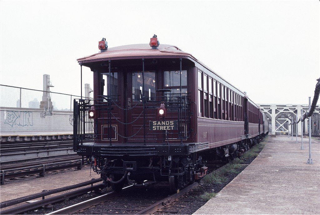 (193k, 1024x689)<br><b>Country:</b> United States<br><b>City:</b> New York<br><b>System:</b> New York City Transit<br><b>Line:</b> IND Crosstown Line<br><b>Location:</b> Smith/9th Street <br><b>Route:</b> Fan Trip<br><b>Car:</b> BMT Elevated Gate Car 1407/1273/1404 <br><b>Photo by:</b> Aron Eisenpress<br><b>Collection of:</b> Joe Testagrose<br><b>Date:</b> 8/31/1979<br><b>Viewed (this week/total):</b> 1 / 706