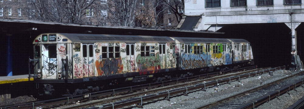 (66k, 1000x359)<br><b>Country:</b> United States<br><b>City:</b> New York<br><b>System:</b> New York City Transit<br><b>Line:</b> IRT Dyre Ave. Line<br><b>Location:</b> Morris Park <br><b>Route:</b> 5<br><b>Car:</b> R-33 Main Line (St. Louis, 1962-63) 8957 <br><b>Photo by:</b> Robert Callahan<br><b>Date:</b> 3/9/1985<br><b>Viewed (this week/total):</b> 1 / 1275