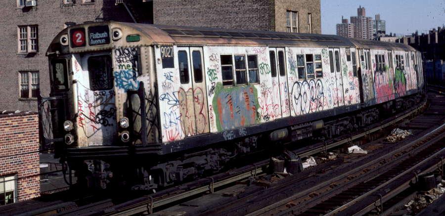 (70k, 900x437)<br><b>Country:</b> United States<br><b>City:</b> New York<br><b>System:</b> New York City Transit<br><b>Line:</b> IRT White Plains Road Line<br><b>Location:</b> Bronx Park East <br><b>Route:</b> 2<br><b>Car:</b> R-33 Main Line (St. Louis, 1962-63) 9027 <br><b>Photo by:</b> Robert Callahan<br><b>Date:</b> 3/9/1985<br><b>Viewed (this week/total):</b> 0 / 912
