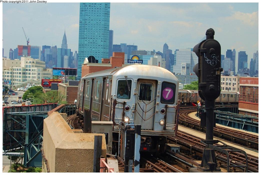 (360k, 1044x701)<br><b>Country:</b> United States<br><b>City:</b> New York<br><b>System:</b> New York City Transit<br><b>Line:</b> IRT Flushing Line<br><b>Location:</b> 33rd Street/Rawson Street <br><b>Route:</b> 7<br><b>Car:</b> R-62A (Bombardier, 1984-1987)  2032 <br><b>Photo by:</b> John Dooley<br><b>Date:</b> 6/27/2011<br><b>Viewed (this week/total):</b> 0 / 971