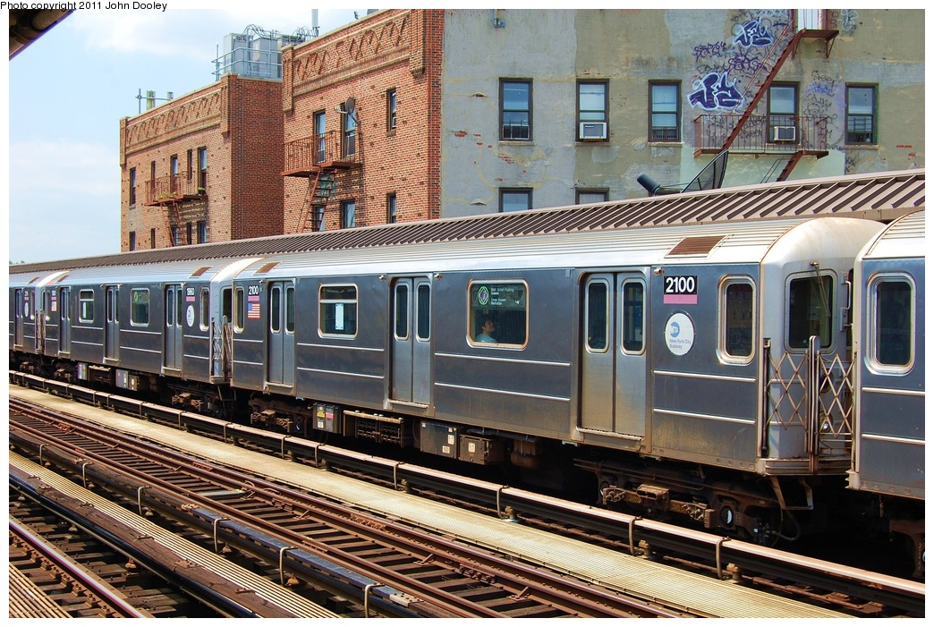 (414k, 1044x701)<br><b>Country:</b> United States<br><b>City:</b> New York<br><b>System:</b> New York City Transit<br><b>Line:</b> IRT Flushing Line<br><b>Location:</b> 52nd Street/Lincoln Avenue <br><b>Route:</b> 7<br><b>Car:</b> R-62A (Bombardier, 1984-1987)  2100 <br><b>Photo by:</b> John Dooley<br><b>Date:</b> 6/27/2011<br><b>Viewed (this week/total):</b> 0 / 922