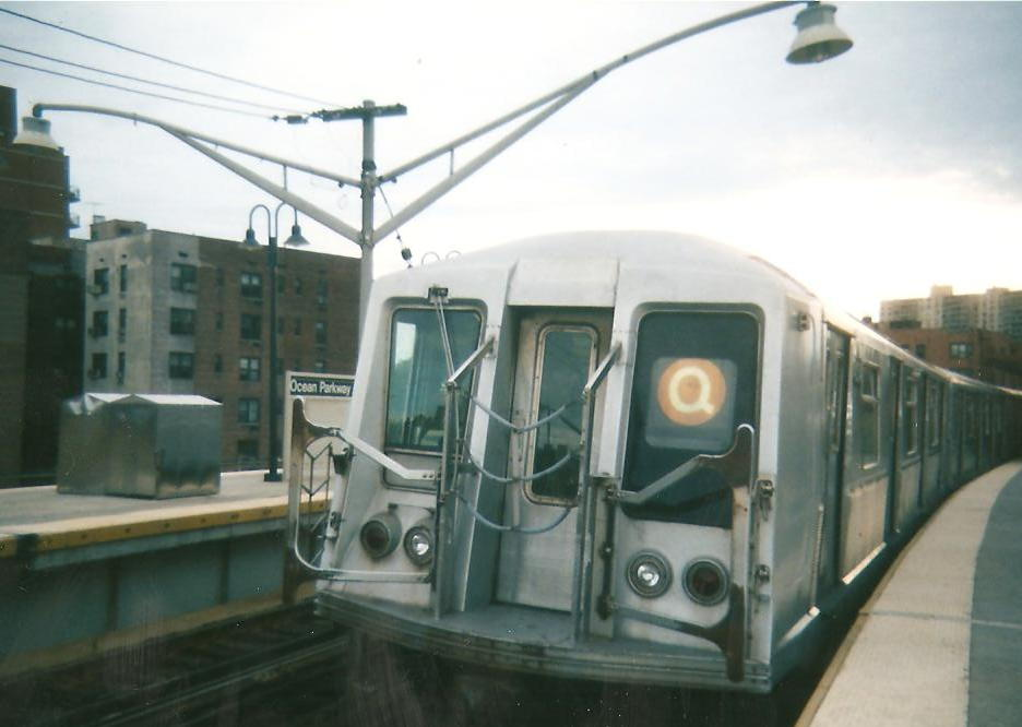 (68k, 936x666)<br><b>Country:</b> United States<br><b>City:</b> New York<br><b>System:</b> New York City Transit<br><b>Line:</b> BMT Brighton Line<br><b>Location:</b> Ocean Parkway <br><b>Route:</b> Q yard move<br><b>Car:</b> R-40 (St. Louis, 1968)   <br><b>Photo by:</b> Zach Summer<br><b>Date:</b> 1999<br><b>Notes:</b> Summer 1999<br><b>Viewed (this week/total):</b> 1 / 1316