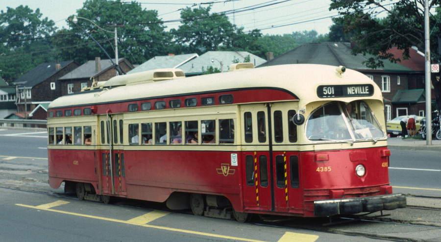 (69k, 900x494)<br><b>Country:</b> Canada<br><b>City:</b> Toronto<br><b>System:</b> TTC<br><b>Line:</b> TTC 501-Queen<br><b>Location:</b> The Queensway/Glendale <br><b>Route:</b> 501 Neville Park<br><b>Car:</b> PCC (TTC Toronto) 4385 <br><b>Photo by:</b> Robert Callahan<br><b>Date:</b> 8/9/1981<br><b>Viewed (this week/total):</b> 1 / 422
