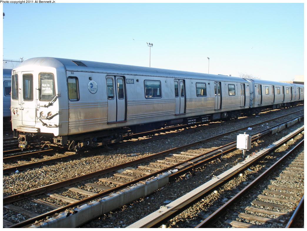 (500k, 1044x788)<br><b>Country:</b> United States<br><b>City:</b> New York<br><b>System:</b> New York City Transit<br><b>Location:</b> Rockaway Park Yard<br><b>Car:</b> R-46 (Pullman-Standard, 1974-75) 6164 <br><b>Photo by:</b> Al Bennett, Jr.<br><b>Date:</b> 4/21/2011<br><b>Viewed (this week/total):</b> 0 / 594