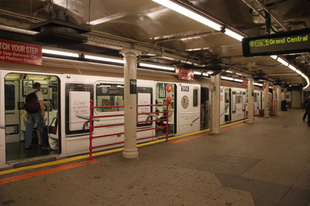 (107k, 1024x683)<br><b>Country:</b> United States<br><b>City:</b> New York<br><b>System:</b> New York City Transit<br><b>Line:</b> IRT Times Square-Grand Central Shuttle<br><b>Location:</b> Times Square <br><b>Route:</b> S<br><b>Car:</b> R-62A (Bombardier, 1984-1987)  1956 <br><b>Photo by:</b> Robbie Rosenfeld<br><b>Date:</b> 9/11/2011<br><b>Notes:</b> HTC ad wrap.<br><b>Viewed (this week/total):</b> 0 / 1541