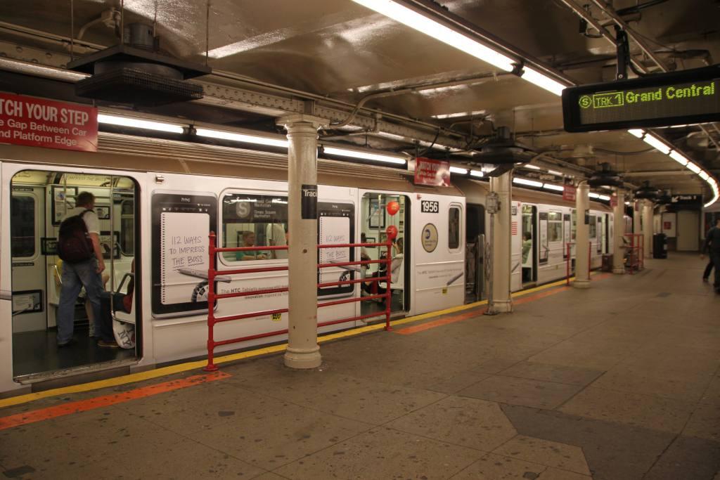(107k, 1024x683)<br><b>Country:</b> United States<br><b>City:</b> New York<br><b>System:</b> New York City Transit<br><b>Line:</b> IRT Times Square-Grand Central Shuttle<br><b>Location:</b> Times Square <br><b>Route:</b> S<br><b>Car:</b> R-62A (Bombardier, 1984-1987)  1956 <br><b>Photo by:</b> Robbie Rosenfeld<br><b>Date:</b> 9/11/2011<br><b>Notes:</b> HTC ad wrap.<br><b>Viewed (this week/total):</b> 5 / 1500