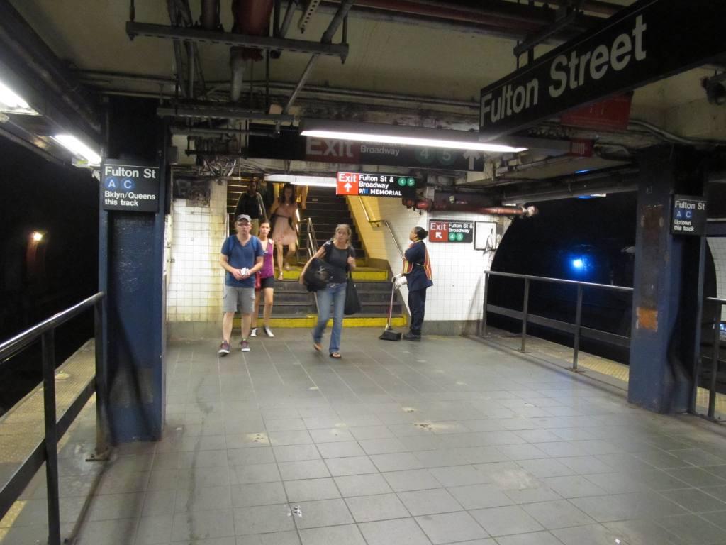 (94k, 1024x768)<br><b>Country:</b> United States<br><b>City:</b> New York<br><b>System:</b> New York City Transit<br><b>Line:</b> IND 8th Avenue Line<br><b>Location:</b> Fulton Street (Broadway/Nassau) <br><b>Photo by:</b> Robbie Rosenfeld<br><b>Date:</b> 9/14/2011<br><b>Notes:</b> New Fulton signs at Fulton-Broadway/Nassau<br><b>Viewed (this week/total):</b> 1 / 1941