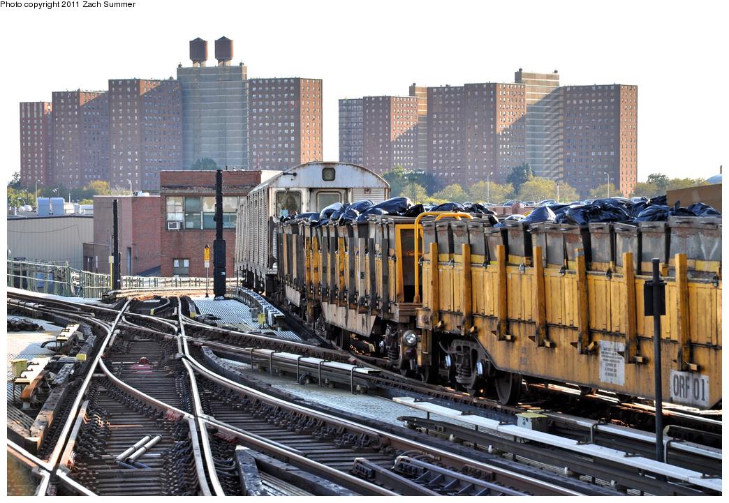 (445k, 1044x721)<br><b>Country:</b> United States<br><b>City:</b> New York<br><b>System:</b> New York City Transit<br><b>Line:</b> BMT Culver Line<br><b>Location:</b> Avenue X <br><b>Route:</b> Work Service<br><b>Car:</b> R-32 (Budd, 1964)  3494 <br><b>Photo by:</b> Zach Summer<br><b>Date:</b> 10/7/2011<br><b>Notes:</b> With R-58 refuse flats 02/01 on Garbage Train<br><b>Viewed (this week/total):</b> 0 / 1103