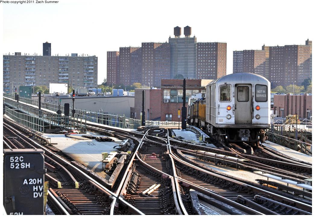 (443k, 1044x724)<br><b>Country:</b> United States<br><b>City:</b> New York<br><b>System:</b> New York City Transit<br><b>Line:</b> BMT Culver Line<br><b>Location:</b> Avenue X <br><b>Route:</b> Work Service<br><b>Car:</b> R-127/R-134 (Kawasaki, 1991-1996) EP010 <br><b>Photo by:</b> Zach Summer<br><b>Date:</b> 10/7/2011<br><b>Notes:</b> Garbage Train<br><b>Viewed (this week/total):</b> 3 / 1265