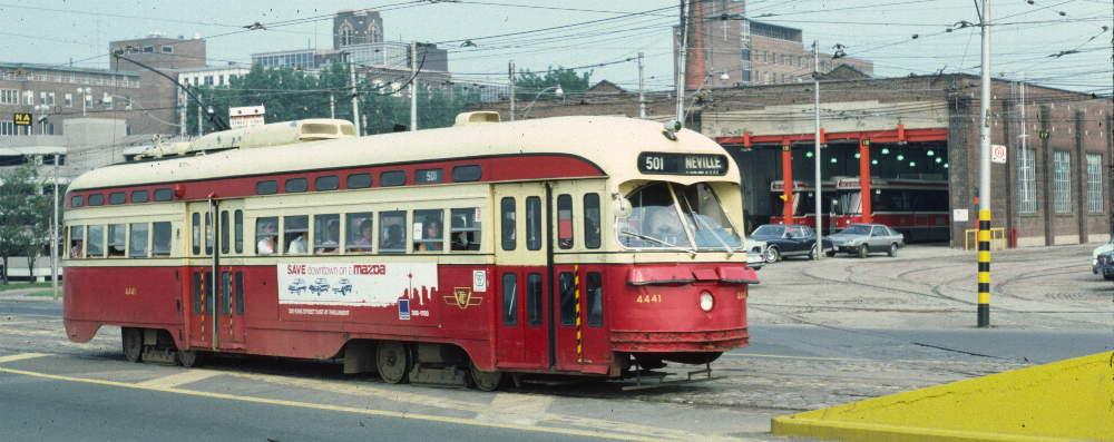 (68k, 1000x397)<br><b>Country:</b> Canada<br><b>City:</b> Toronto<br><b>System:</b> TTC<br><b>Line:</b> TTC 501-Queen<br><b>Location:</b> The Queensway/Roncesvalles Carhouse <br><b>Car:</b> PCC (TTC Toronto) 4441 <br><b>Photo by:</b> Robert Callahan<br><b>Date:</b> 8/10/1981<br><b>Notes:</b> 501 Neville Park.  <br><b>Viewed (this week/total):</b> 1 / 541