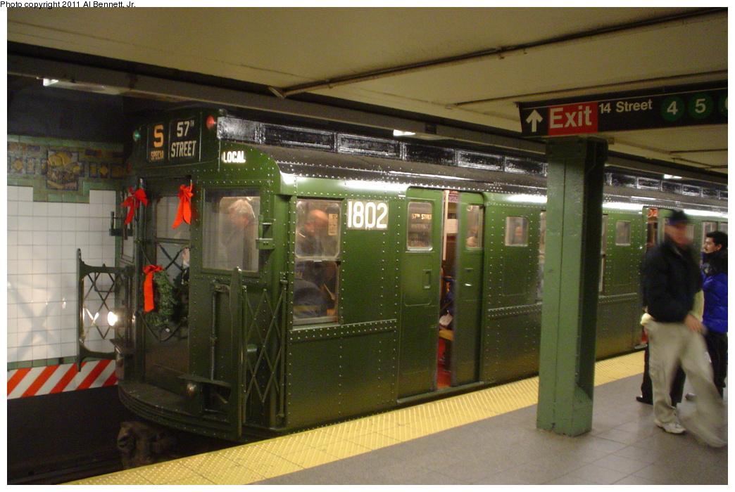 (325k, 1044x700)<br><b>Country:</b> United States<br><b>City:</b> New York<br><b>System:</b> New York City Transit<br><b>Line:</b> BMT Broadway Line<br><b>Location:</b> 14th Street/Union Square <br><b>Route:</b> Fan Trip<br><b>Car:</b> R-9 (Pressed Steel, 1940)  1802 <br><b>Photo by:</b> Al Bennett, Jr.<br><b>Date:</b> 12/12/2004<br><b>Viewed (this week/total):</b> 1 / 1041
