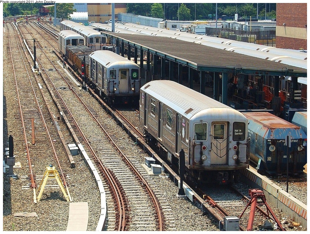 (600k, 1044x787)<br><b>Country:</b> United States<br><b>City:</b> New York<br><b>System:</b> New York City Transit<br><b>Location:</b> Corona Yard<br><b>Car:</b> R-62A (Bombardier, 1984-1987)  2019/2157 <br><b>Photo by:</b> John Dooley<br><b>Date:</b> 6/27/2011<br><b>Notes:</b> 2157 with 6 line bullet on garbage train duty.<br><b>Viewed (this week/total):</b> 1 / 1123