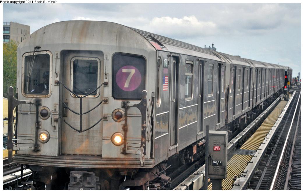 (343k, 1044x663)<br><b>Country:</b> United States<br><b>City:</b> New York<br><b>System:</b> New York City Transit<br><b>Line:</b> IRT Flushing Line<br><b>Location:</b> 69th Street/Fisk Avenue <br><b>Route:</b> 7<br><b>Car:</b> R-62A (Bombardier, 1984-1987)  1791 <br><b>Photo by:</b> Zach Summer<br><b>Date:</b> 10/12/2011<br><b>Viewed (this week/total):</b> 0 / 897