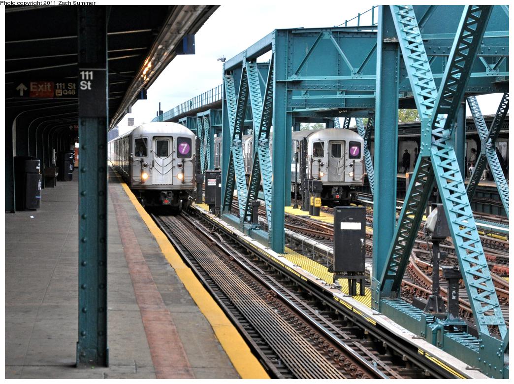 (496k, 1044x779)<br><b>Country:</b> United States<br><b>City:</b> New York<br><b>System:</b> New York City Transit<br><b>Line:</b> IRT Flushing Line<br><b>Location:</b> 111th Street <br><b>Route:</b> 7<br><b>Car:</b> R-62A (Bombardier, 1984-1987)  2034/2154 <br><b>Photo by:</b> Zach Summer<br><b>Date:</b> 10/12/2011<br><b>Viewed (this week/total):</b> 0 / 1146