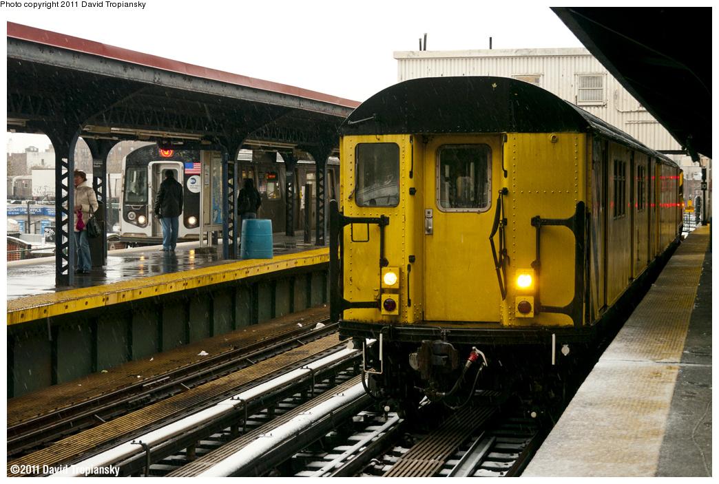 (404k, 1044x703)<br><b>Country:</b> United States<br><b>City:</b> New York<br><b>System:</b> New York City Transit<br><b>Line:</b> BMT Brighton Line<br><b>Location:</b> Brighton Beach <br><b>Route:</b> Work Service<br><b>Car:</b> R-161 Rider Car (ex-R-33)  RD437 <br><b>Photo by:</b> David Tropiansky<br><b>Date:</b> 10/29/2011<br><b>Notes:</b> De-icer train.<br><b>Viewed (this week/total):</b> 0 / 1037