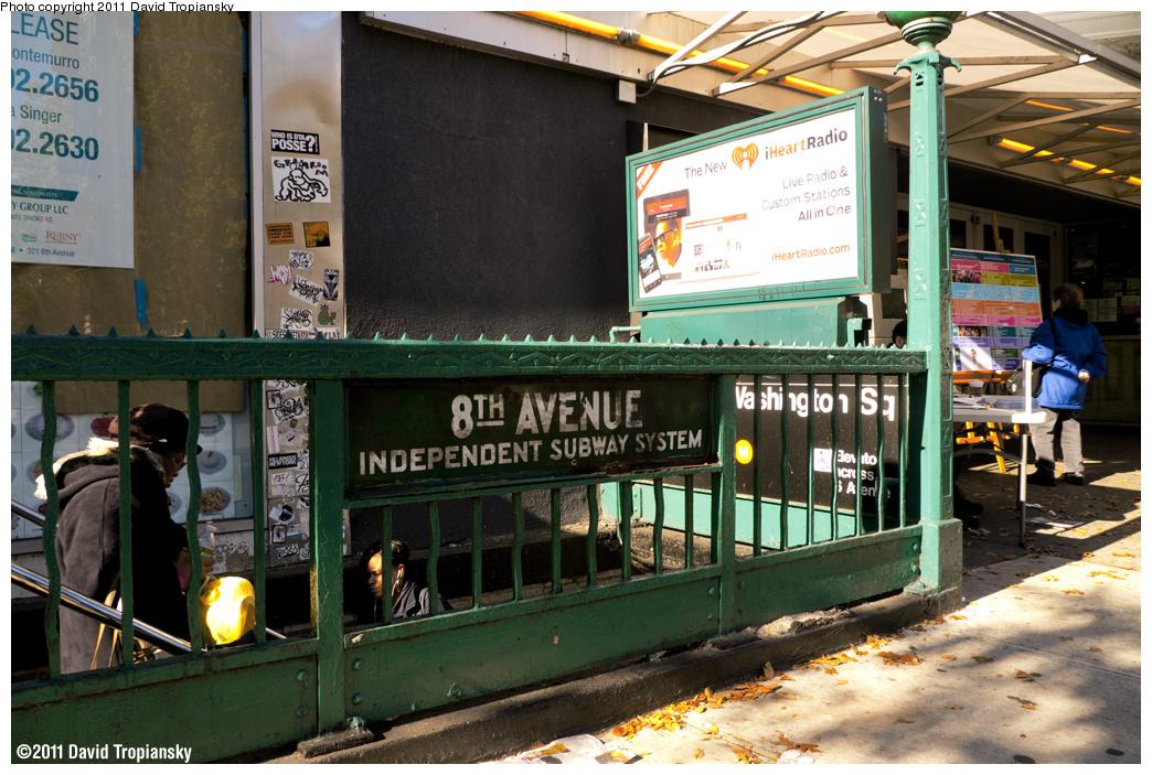 (432k, 1044x703)<br><b>Country:</b> United States<br><b>City:</b> New York<br><b>System:</b> New York City Transit<br><b>Line:</b> IND 8th Avenue Line<br><b>Location:</b> West 4th Street/Washington Square <br><b>Photo by:</b> David Tropiansky<br><b>Date:</b> 11/4/2011<br><b>Notes:</b> Station entrance. Note the original IND signage.<br><b>Viewed (this week/total):</b> 3 / 1399
