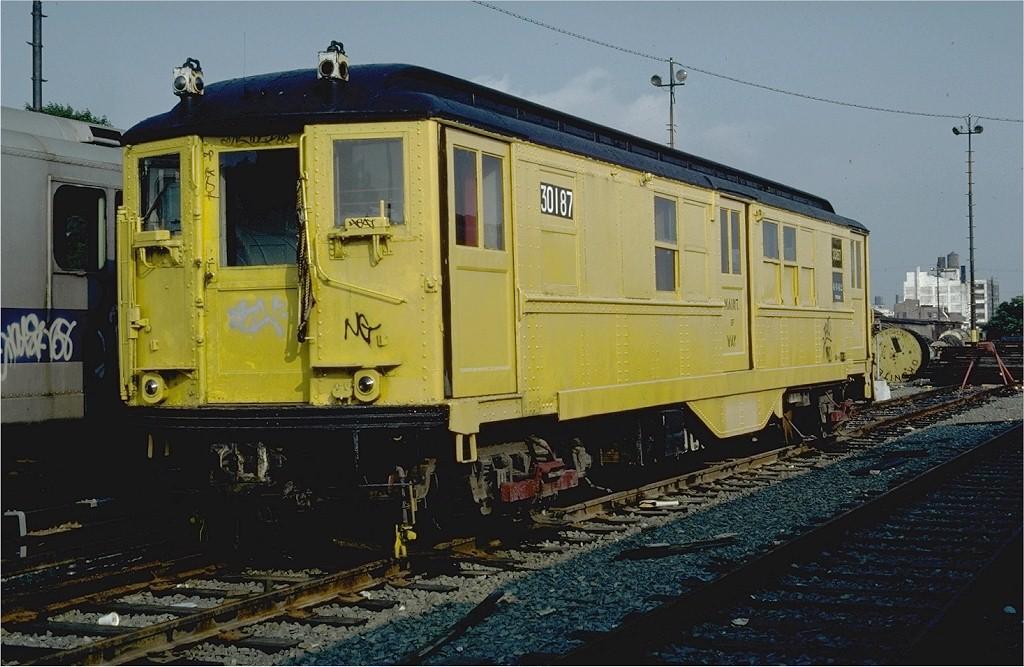 (195k, 1024x667)<br><b>Country:</b> United States<br><b>City:</b> New York<br><b>System:</b> New York City Transit<br><b>Location:</b> 36th Street Yard<br><b>Car:</b> Low-V 30187 (ex-4642)<br><b>Photo by:</b> Steve Zabel<br><b>Collection of:</b> Joe Testagrose<br><b>Date:</b> 6/19/1981<br><b>Viewed (this week/total):</b> 0 / 2169