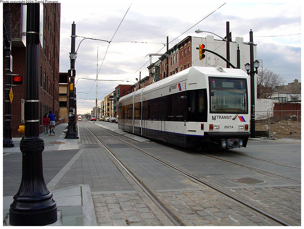 (273k, 1044x788)<br><b>Country:</b> United States<br><b>City:</b> Jersey City, NJ<br><b>System:</b> Hudson Bergen Light Rail<br><b>Location:</b> Essex Street <br><b>Car:</b> NJT-HBLR LRV (Kinki-Sharyo, 1998-99)  2027 <br><b>Photo by:</b> David Pirmann<br><b>Date:</b> 3/26/2000<br><b>Viewed (this week/total):</b> 2 / 2597