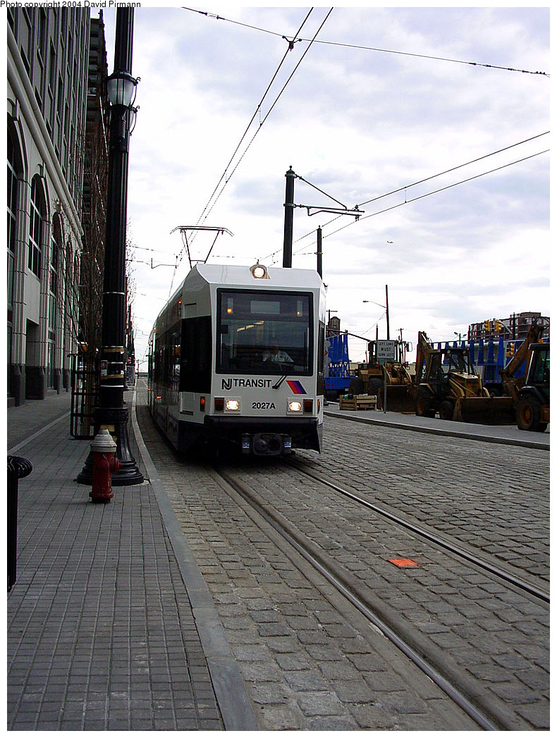 (270k, 790x1047)<br><b>Country:</b> United States<br><b>City:</b> Jersey City, NJ<br><b>System:</b> Hudson Bergen Light Rail<br><b>Location:</b> Exchange Place <br><b>Car:</b> NJT-HBLR LRV (Kinki-Sharyo, 1998-99)  2027 <br><b>Photo by:</b> David Pirmann<br><b>Date:</b> 3/26/2000<br><b>Viewed (this week/total):</b> 0 / 2262